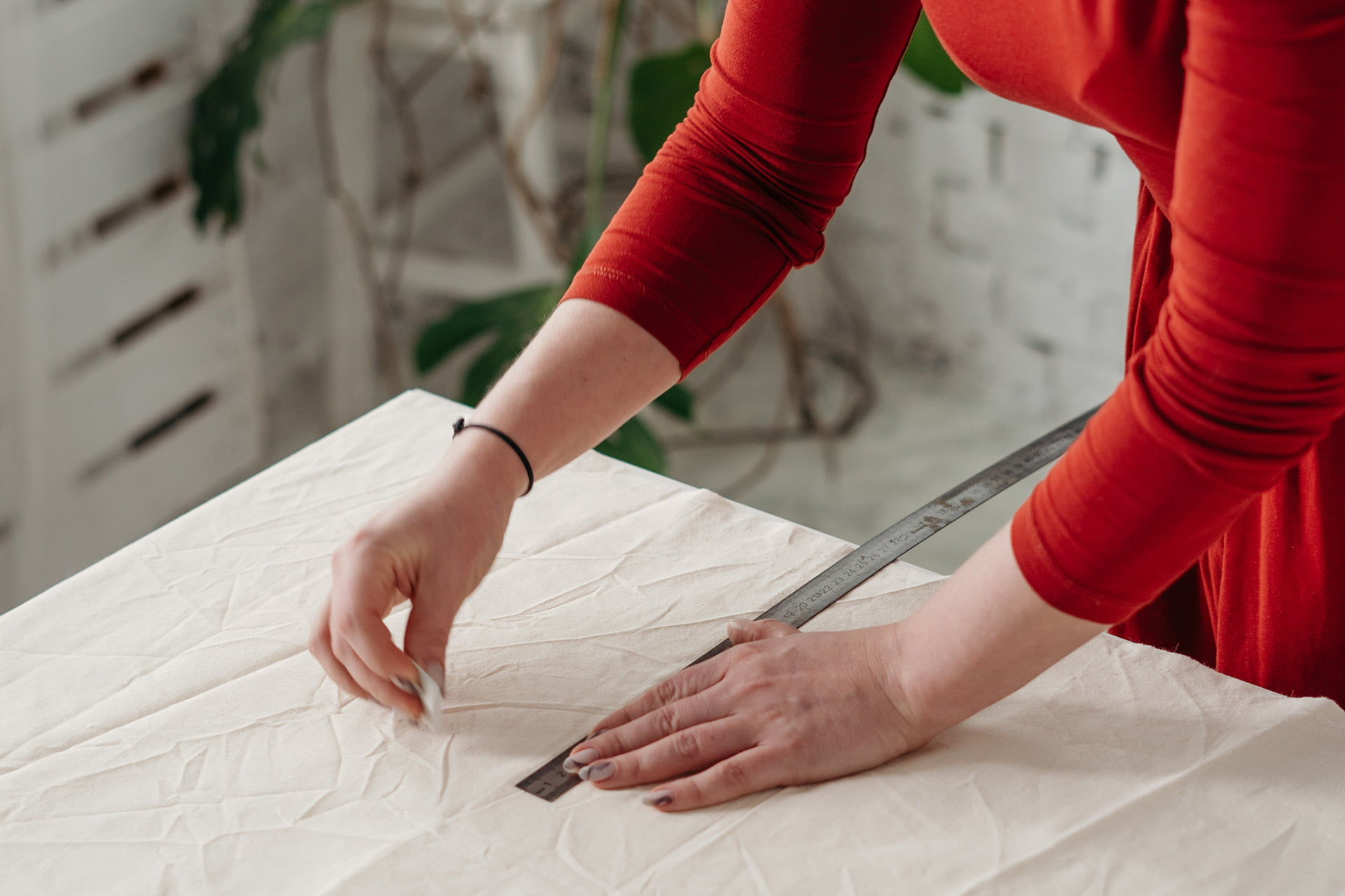woman creating pattern for wedding dress