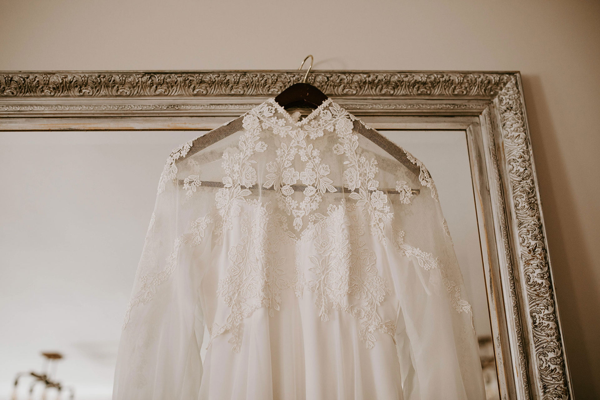 wedding dress hanging from the mirror