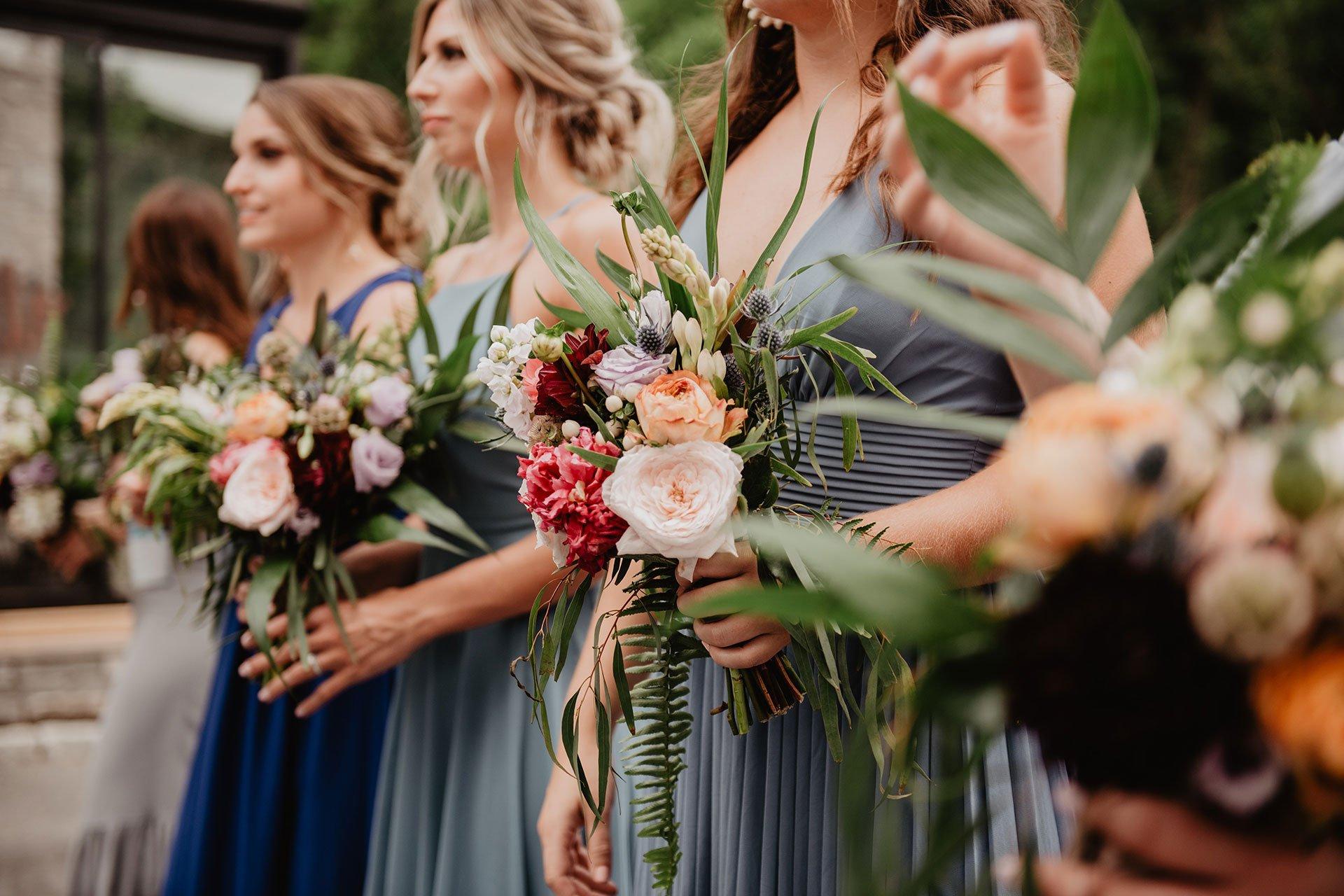 Women Holding Wedding Flowers