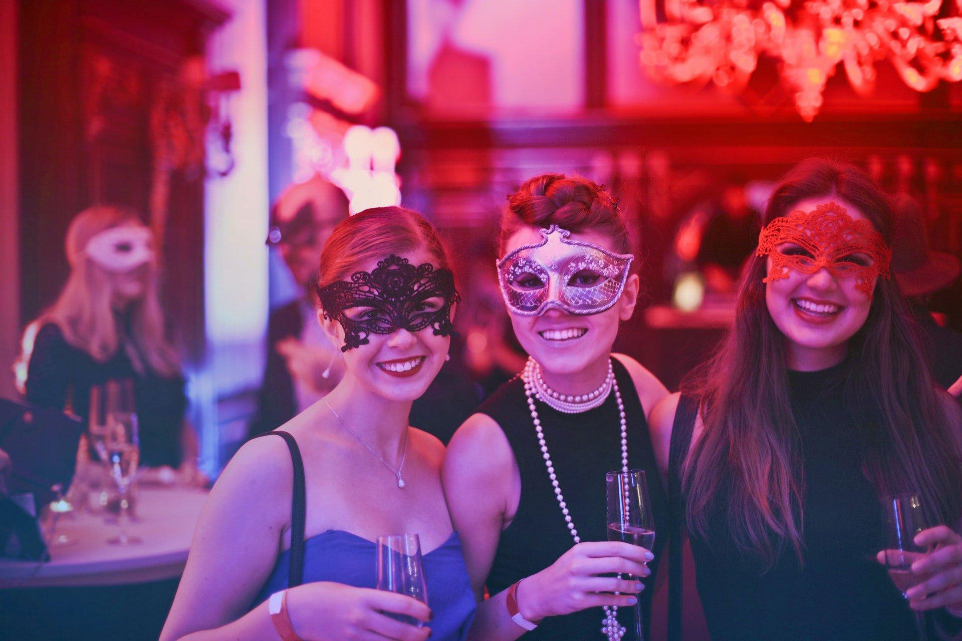 Women Wearing Eye Mask at Masquerade Party